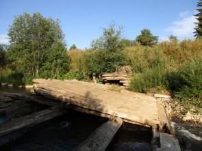 Затвор плотины из лиственницы. Автор: Михаил Латышев